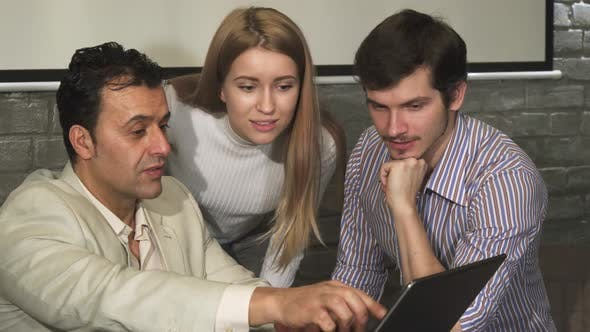 Thumbnail for Group of Business People Discussing Something on the Laptop During the Meeting
