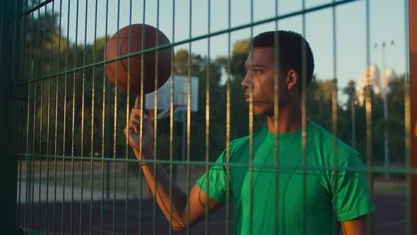 Skillful Athlete Spinning Basketball on Finger