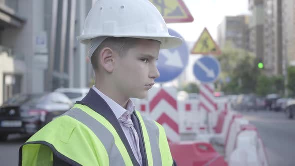 Thumbnail for Cute Little Successful Boy Wearing Business Suit and Safety Equipment and Constructor Helmet