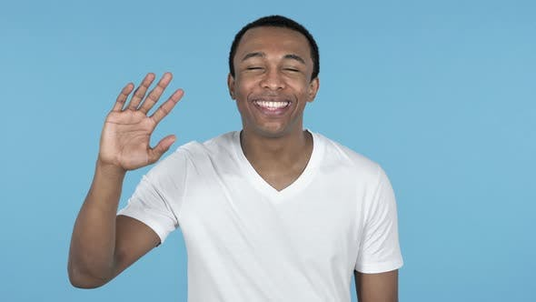 Thumbnail for African Man Waving Hand To Welcome Blue Background