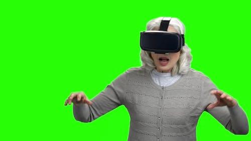 Old Woman Wearing Virtual Reality Headset