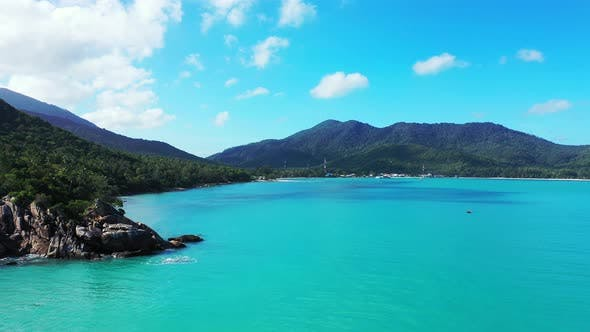 Thumbnail for Beautiful fly over clean view of a sunshine white sandy paradise beach and aqua blue ocean backgroun
