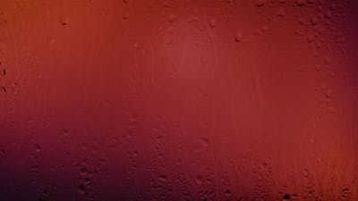 Raindrops On Glass. Light Leaks In Background