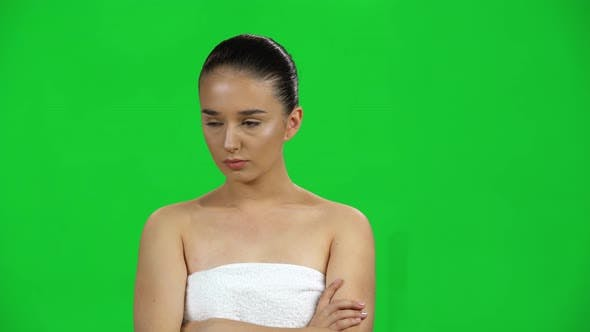 Thumbnail for Lovely Girl in Towel Is Very Offended and Looks Away on Green Screen at Studio