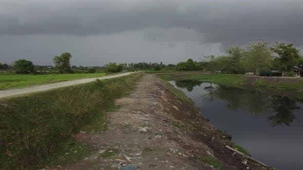 Move at polluted river bank