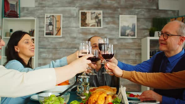 Cover Image for Happy Young Family Toasting with Wine Glasses