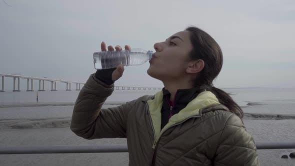 Thumbnail for Smiling Hindu Woman Drinking Water During Workout