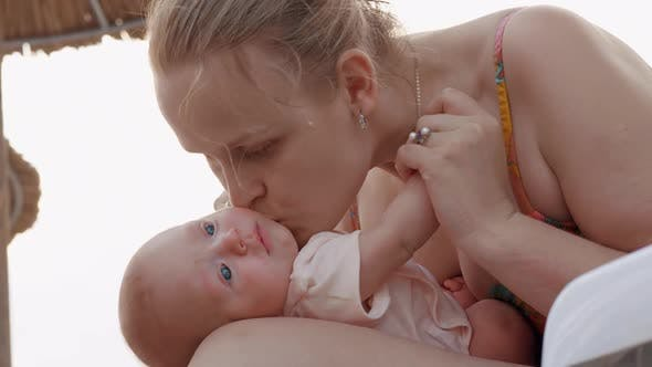 Thumbnail for Mother Kissing Beloved Baby Daughter