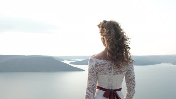 Magical and Mystic Girl Looking To the Coast From a Cliff