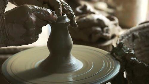 Male Hands Making Ceramic Vase in Pottery Workshop