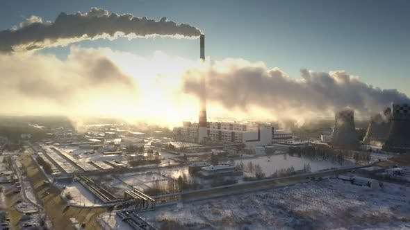 Thumbnail for Upper View Huge Power Plant Steam Smoke Clouds Hide Sun Rays