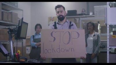Man Holding Anti-lockdown Message