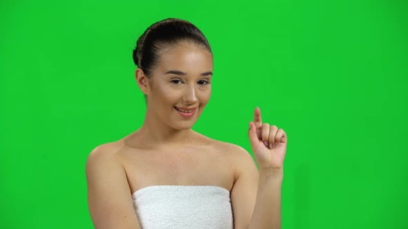 Thumbnail for Attractive Woman in White Towel Smiles Coquettishly and Waving Finger No, Green Screen