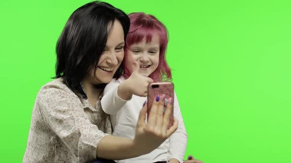 Thumbnail for Mother, Daughter Holding, Using Smart Phone Talking on Video Call. Social Media