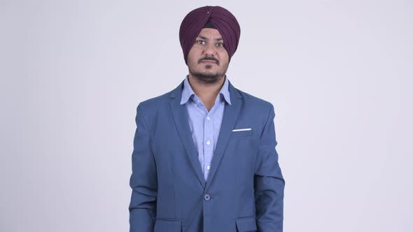 Thumbnail for Happy Bearded Indian Sikh Businessman Smiling