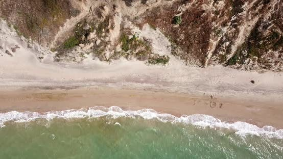 Thumbnail for Top Down View of Waves Breaking in the Sand, Flying Over Tropical Sandy Beach and Waves
