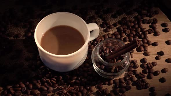 Thumbnail for Coffee Beans, Cup, with Star Anise and Cinnamon on Sackcloth, Cam Moves To the Right, Shadow