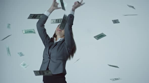 Thumbnail for Businesswoman Catching Falling Money
