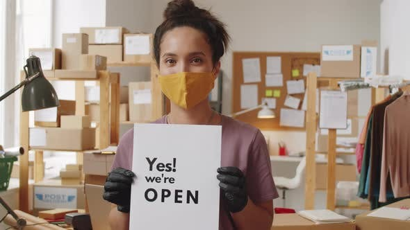 Thumbnail for Woman in Mask and Gloves Posing with Sign about Opening Business