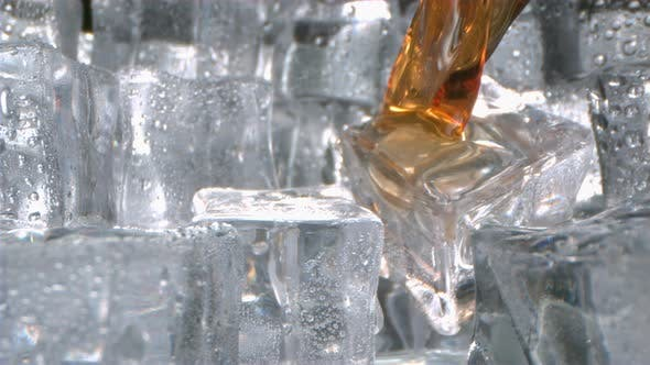 Thumbnail for Whisky Is Pouring Onto Ice Cubes In A Glass In Slow Motion Camera Dollying Out
