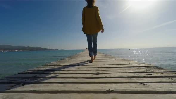Thumbnail for Woman walking on pier