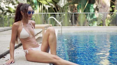 Happy Female in Swimwear Resting on Poolside