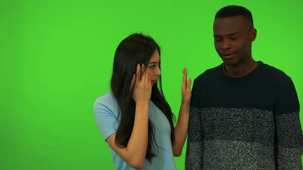 Thumbnail for A Young Asian Woman and a Young Black Man Cry - Green Screen Studio
