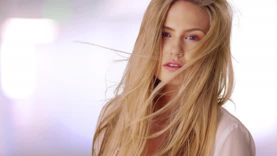 Head shot of pretty female caucasian model posing for camera