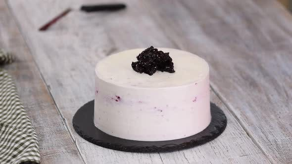 Thumbnail for Confectioner Decorates Cake with Blackcurrant Jam