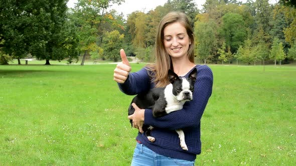 Thumbnail for Young Attractive Happy Woman Hug French Bulldog and Show Thumb Up - Agree