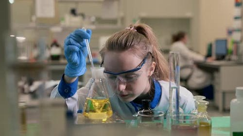 Portrait of Woman Scientist Is Researching Cure for Virus in Pharmaceutical Laboratory Spbas.