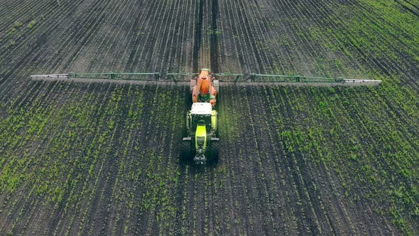 Thumbnail for Aerial View Farm Machinery Spraying Insecticide To the Green Field, Agricultural Natural Seasonal