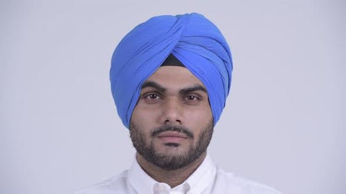 Face of Young Bearded Indian Sikh Man Wearing Turban