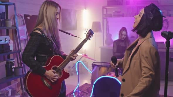 Female Music Band Rocking In Night Club