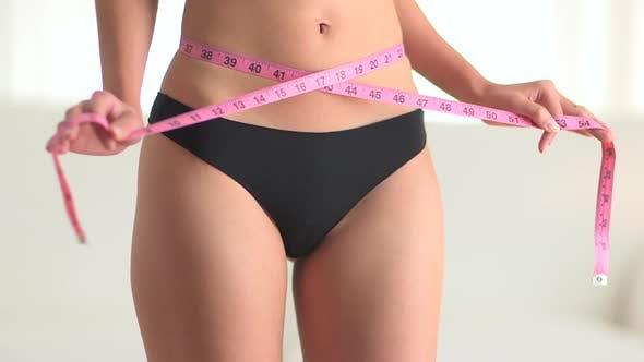 Thumbnail for Asian woman using measuring tape