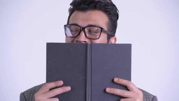 Thumbnail for Face of Persian Businessman Covering Face with Book