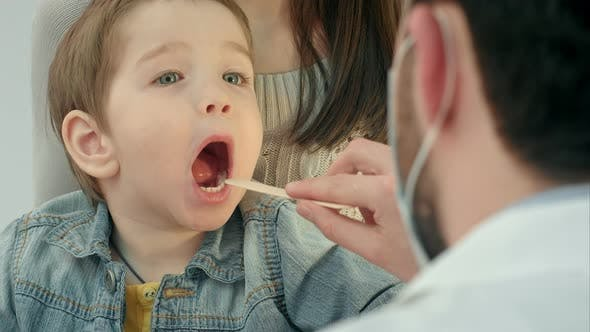 Thumbnail for Little Boy Having Throat Examination