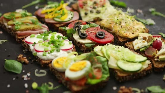 Top View of Different Decorated Sandwiches As Appetizer