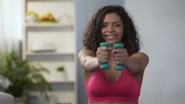 Thumbnail for Mixed Race Woman Working out With Dumbbells at Home, Healthy Lifestyle, Fitness