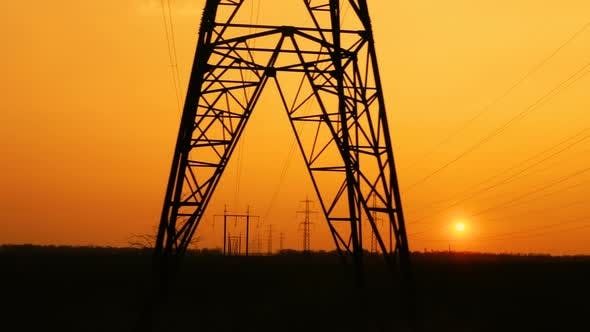 High Voltage Power Lines At The Sunset Time