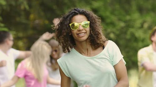 Biracial Woman in Sunglasses at Open-Air Disco, Summer Vacation, Relaxation