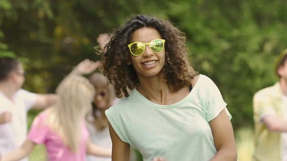 Thumbnail for Biracial Woman in Sunglasses at Open-Air Disco, Summer Vacation, Relaxation