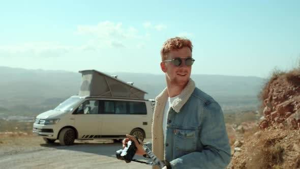 Thumbnail for Young Hipster Man Makes Photos of Camper Van