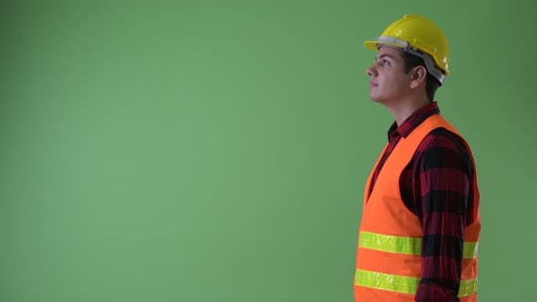 Thumbnail for Profile View of Happy Young Multi Ethnic Man Construction Worker Smiling