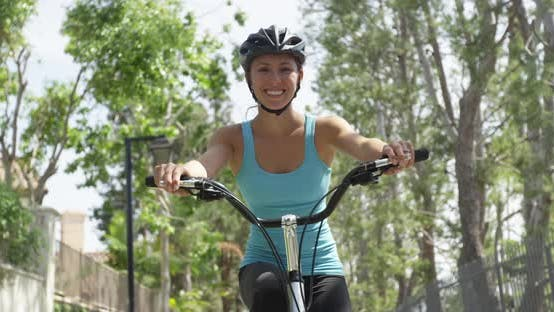 Thumbnail for Happy healthy woman riding bike