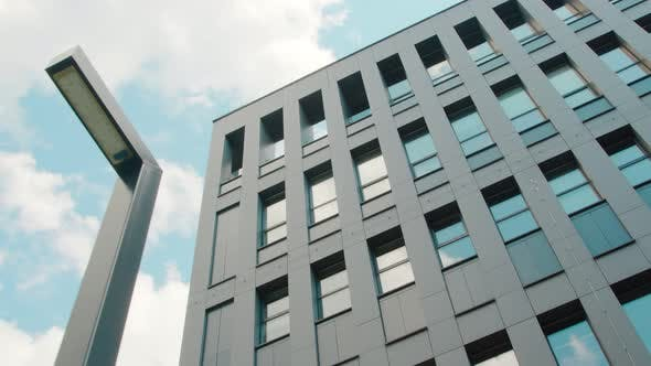 Thumbnail for Part of the Facade of a Modern Business Center Building Is a Bottom-up View. The Sky Reflected in