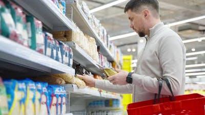 Man Buying Bulgur Wheat in the Supermarket