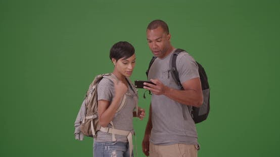 Thumbnail for African American couple search for their destination on green screen