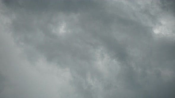 Thumbnail for Real Time Flying Amazing Grey Rain Clouds and Rain Drops.