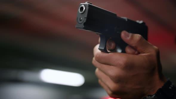 Policeman Hands Aiming Gun
